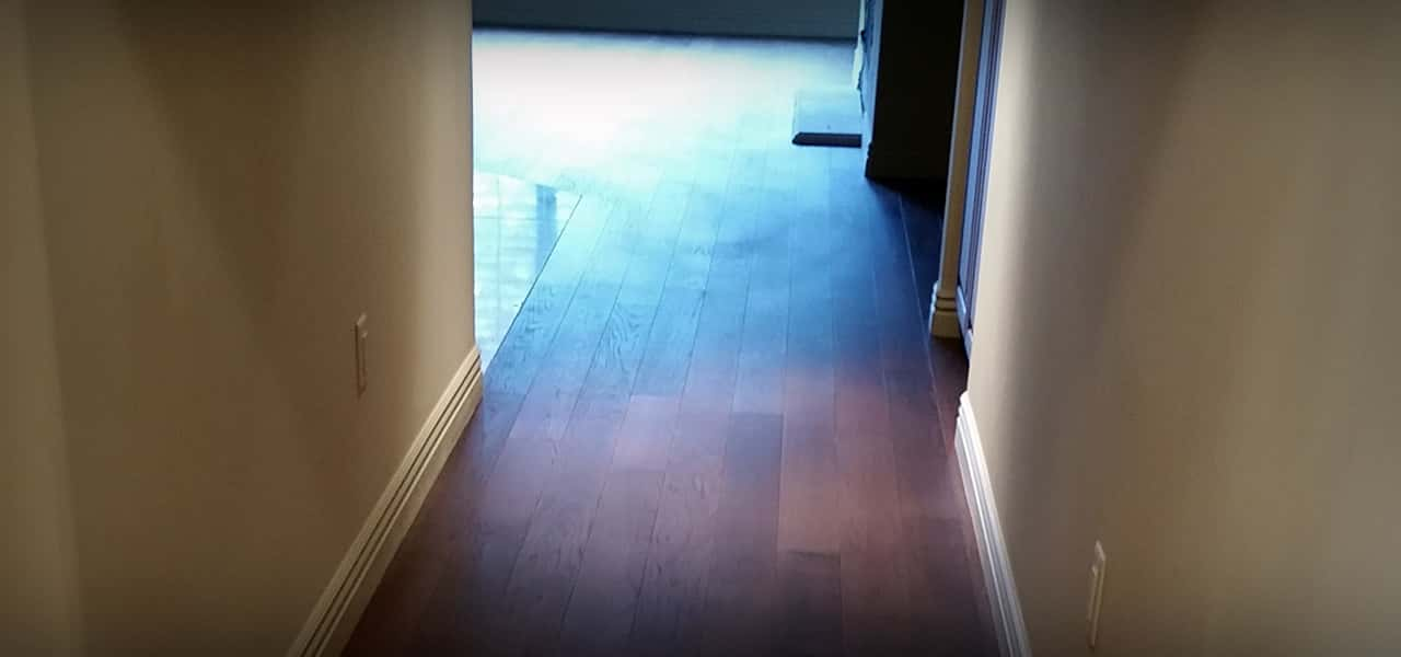 Hardwood floor installation on hallway and livingroom area.